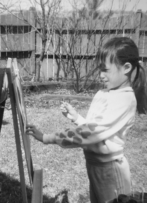 Betsy Lam painting as a kid
